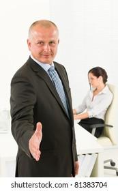 Professional senior businessman handshake in office with secretary