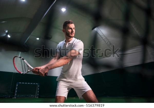 Professional serious man playing tennis