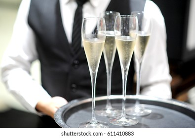 Professional serving champagne