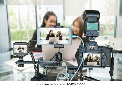 Professional set of camera with smart mobile phone and action camera on tripod over Two Asian young Businesswoman giving the interview via Live stream, Live Streaming for entrepreneur concept