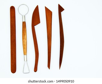 Professional set of tools for modeling clay and clay on a white background