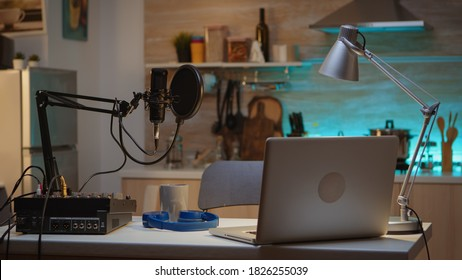 Professional setup for recording podcast in home studio of vlogger. Influencer recording social media content with production microphone. Digital web internet streaming station