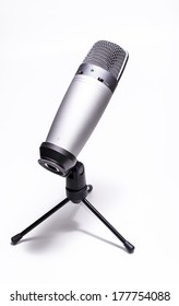 Professional silver microphone with tripod isolated on white background. Back view