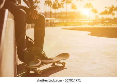 Professional skater resting a bit at the skate park