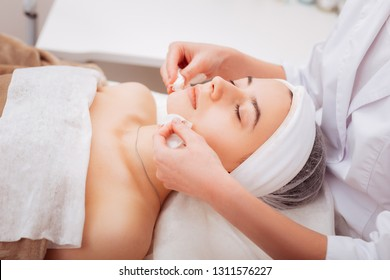 Professional skincare. Beautiful nice woman visiting a cosmetologist while caring about her skin