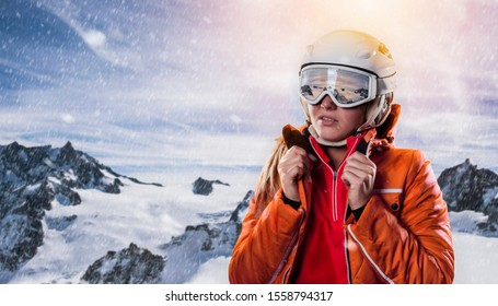 professional snowboarder portrait in wintry panoramic mountain environment. skier with helmet and goggles enjoys vacation ski resort. free space left for your own creativity