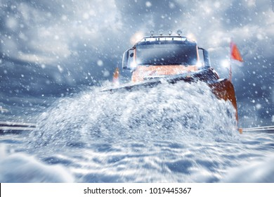 Professional snowplow on a snowy road