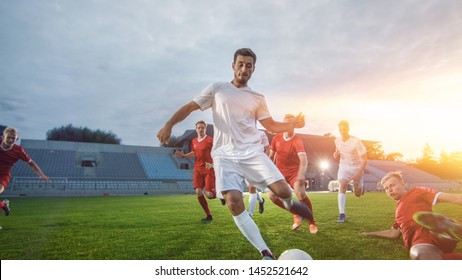 Professional Soccer Player Outruns Members of Opposing Team and Kicks Ball to Score Goal. Soccer Championship on a Stadium. Shot with Warm Sunlight in the Backgrund.