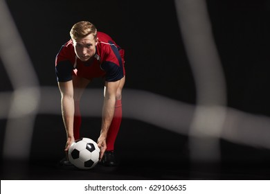 Professional Soccer Player Placing Ball For Penalty Kick
