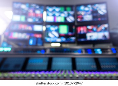 Professional sound engineer's console. Television Broadcast, working with video and audio mixer, control broadcast in recording studio. blurred background, monitors