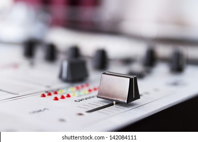 Professional sound equipment for a disc jockey. DJ sound mixer. Crossfader knob regulator in focus. Pro audio technology