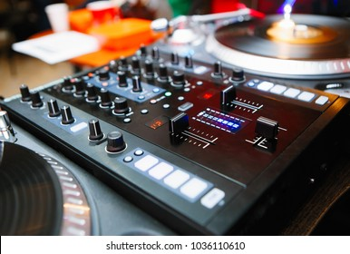 Professional sound mixer controller on night club party.Pro stage audio equipment.Dj sound mixer for playing music.Remix tracks on nightclub party