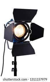 Professional studio lighting on white background. Spotlight with stand. Flashlight with light barn door. Movie studio light.