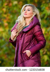 Professional stylist advice. Woman wear extra volume jacket. Girl fashionable blonde walk autumn park. Jackets everyone should have. Best puffer coat to buy. How pick jacket. Puffer fashion concept.