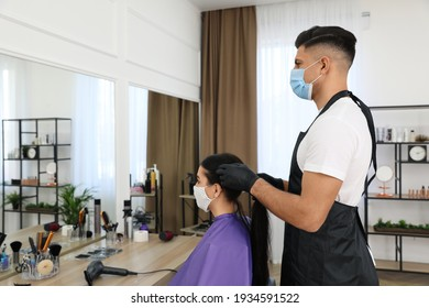 Professional stylist working with client in salon. Hairdressing services during Coronavirus quarantine