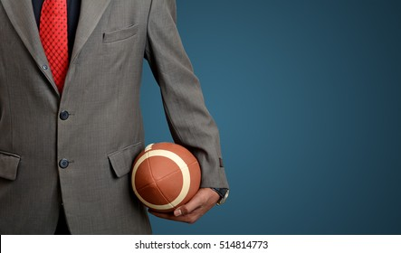 Professional Suited Man with American football ball on blue banner background