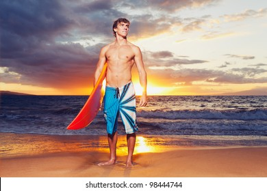 Professional Surfer holding a Surf Board