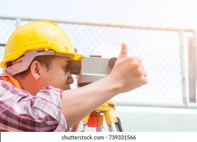 Professional surveyors are working. , Checker, Control and Monitoring Workspace: Close-up Camera by Professional Surveyor