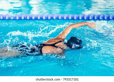 Professional swimmer in training, indoor swimming pool