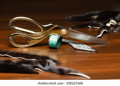 Professional tailor's tools for cutting and sewing, scissors, flexible ruler tape