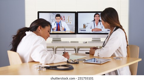 Professional team of multi-ethnic medical doctors having a video conference