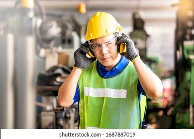 Professional technicians wear protective equipment and hard hats in large industrial plants. Protective and Safety Equipment eye wear, ear plug, vis clothes and protective helmet.