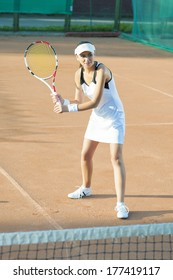 Professional Tennis Player During the Game. Vertical Image