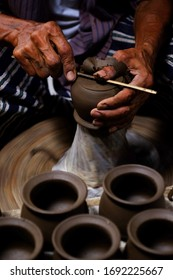 Professional thai old man using mechanic pottery made earthenware at Koh Kret in Nonthaburi Thailand
