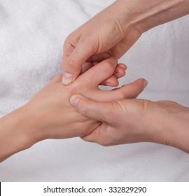 Professional  therapist  doing knuckle massage
