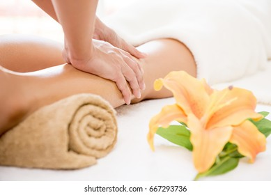 Professional therapist giving traditional thai massage to a woman in spa