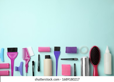 Professional tools for hair dyeing on light blue background, flat lay. Space for text
