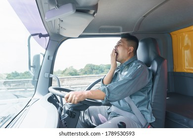 Professional truck driver, adult male, safety belt Yawning and sleepy. Young man worker is confident in the safety of the transport and delivery business for a long time.