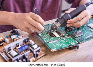 Professional TV repair technicians working in repair shops and television services