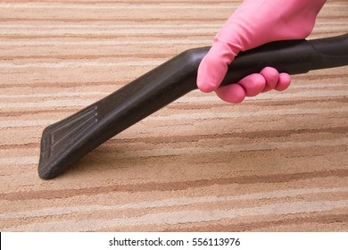 Professional vacuum cleaner nozzle frees the dirty carpet from dust. Early spring cleaning or regular clean up.