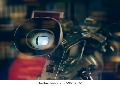 professional video camcorder in studio with blurred background