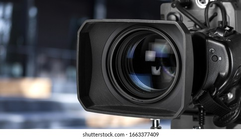 A professional video camera on blur background