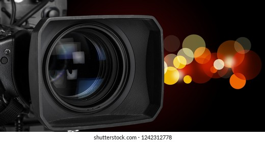 Professional video camera on dark background