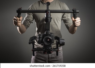 Professional videographer with gimball video slr
