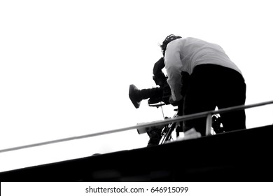 Professional videographer with his camcorder camera on field