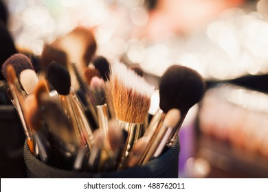 Professional visage brushes for face makeup on table.Body art paint in beauty salon.Close up brush kit
