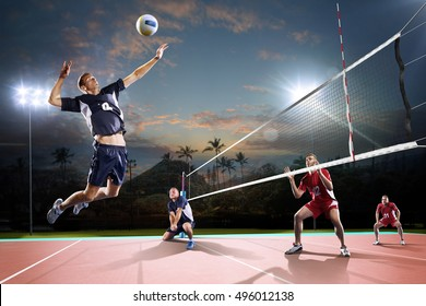 Professional volleyball players in action on the night court