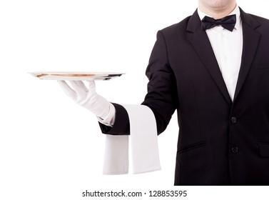 Professional waiter holding an empty dish. Isolated on white background
