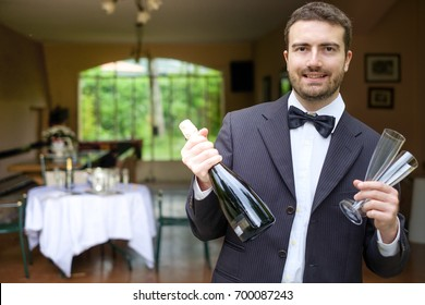 Professional waiter serving sparkling champagne wine glasses