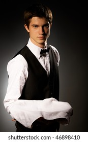 professional waiter in uniform with tray