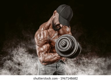 Professional weightlifter is training in the gym. Dumbbell Curl. Bodybuilding concept. Mixed media
