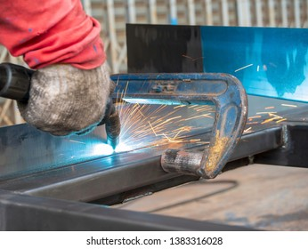 Professional welder welding metal and many fire sparks in the industrial workshop. welder welding metal. sparks metal