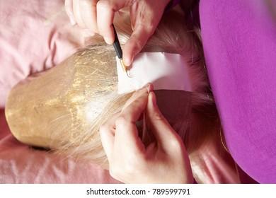 Professional Wig Maker Working in her Workshop.