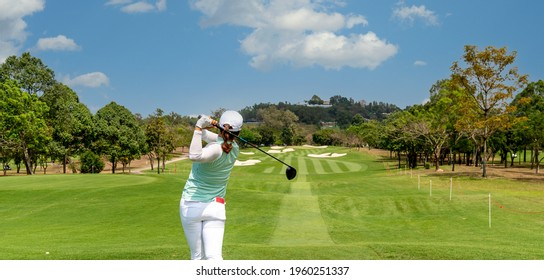 Professional woman golfer teeing golf in golf tournament competition at golf course for winner.   - Shutterstock ID 1960251337