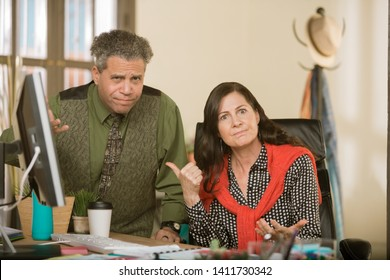 Professional woman reacting to hapless male colleague