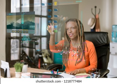 Professional woman working with a futuristic screen in her office